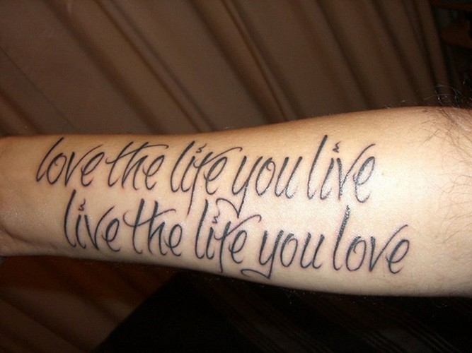 Smart black-lettered quote tattoo on arm