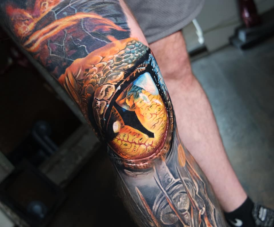 Smaug's eye right on the knee tattoo