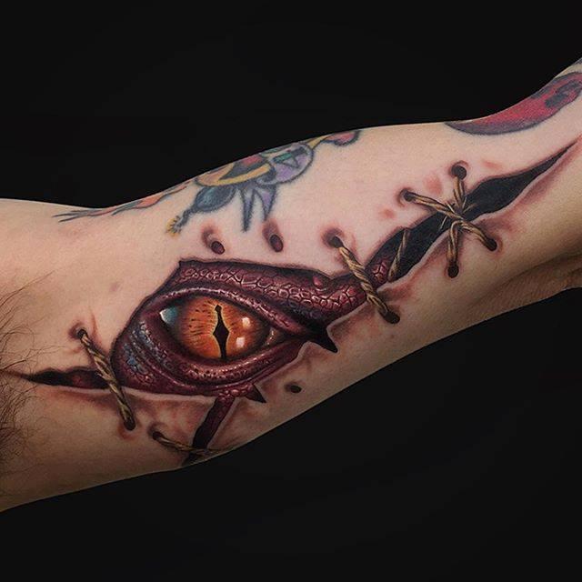 Smaug dragon eye tattoo on art