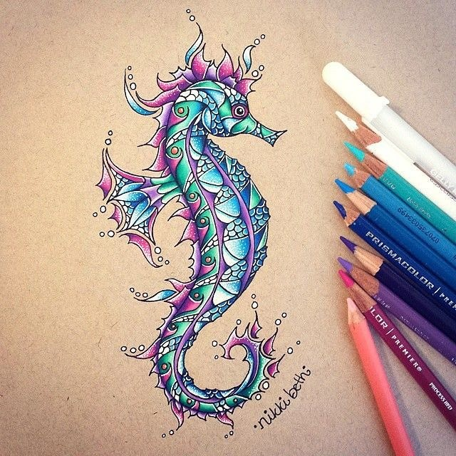 Splendid blue scaled seahorse with pink flippers tattoo design