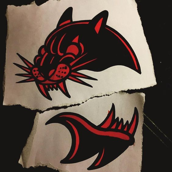 Splendid red-and-black panther head top and jaw tattoo design