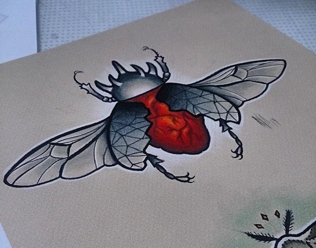 Splendid winged red heart-body bug in horned helmet tattoo design