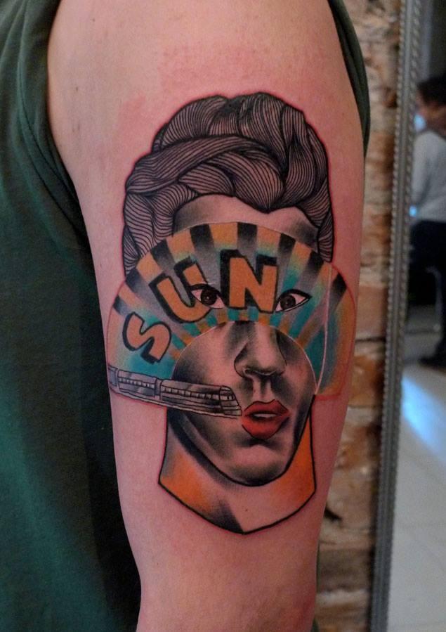 Strange designed by Mariusz Trubisz upper arm tattoo of woman with city train