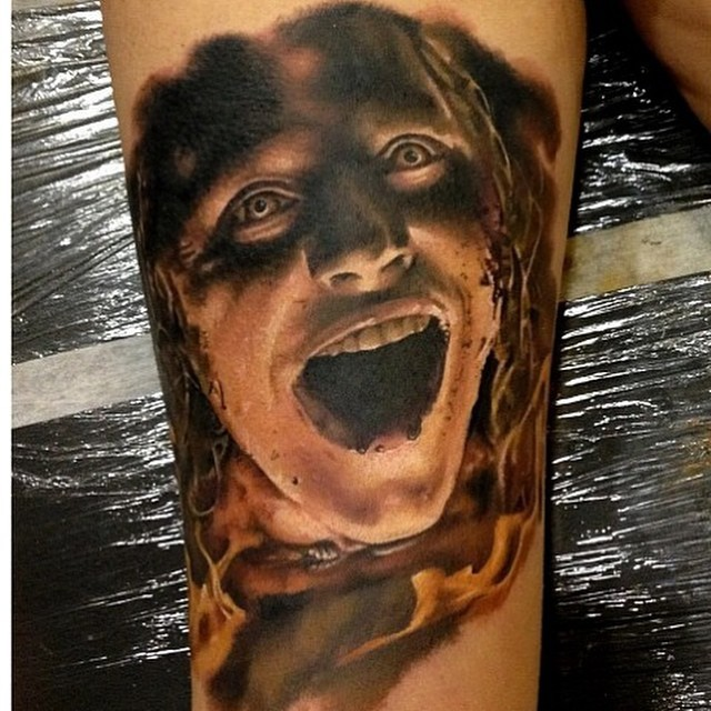 Stunning colored detailed tattoo of demonic man face