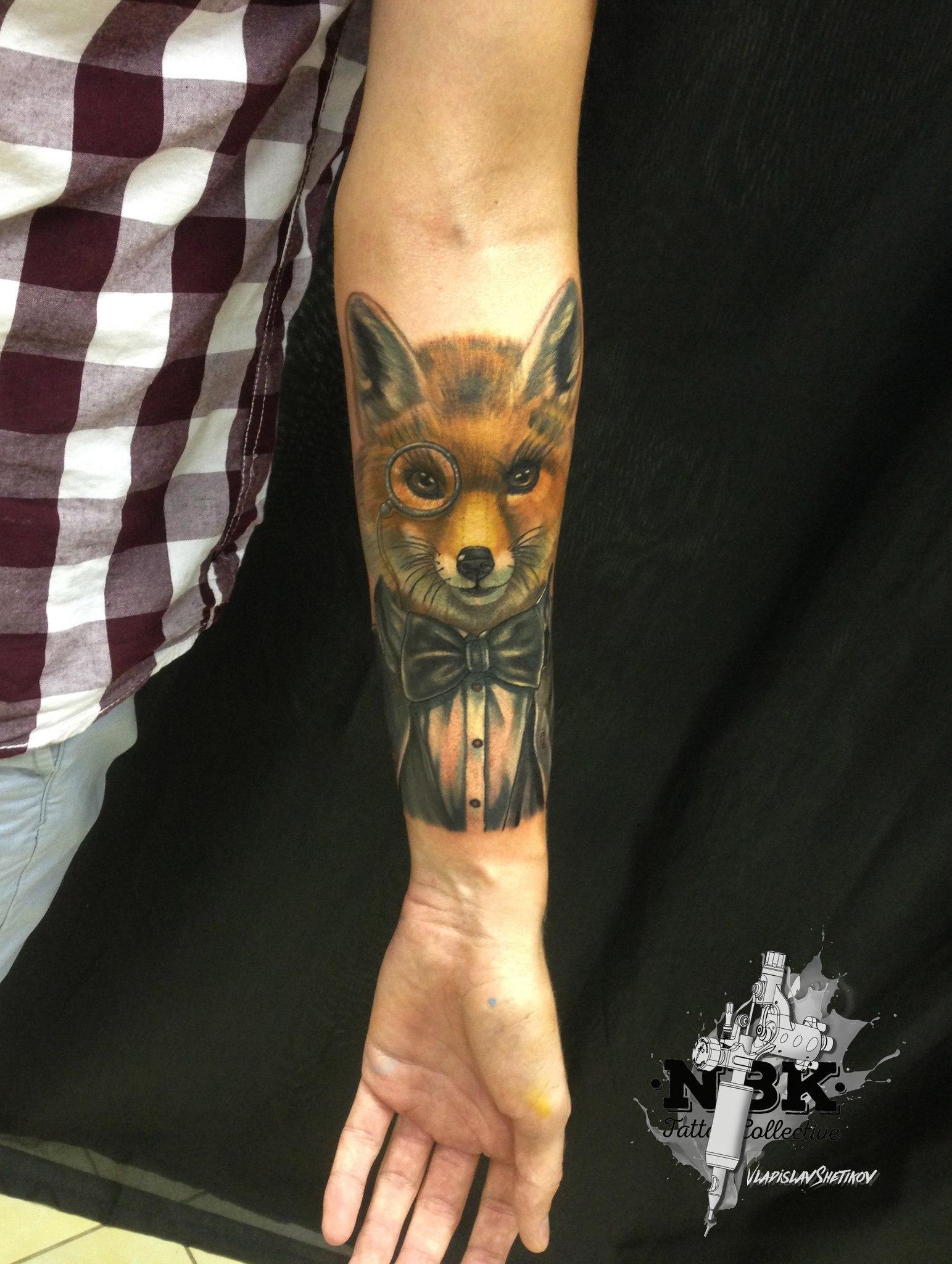 Stylish fox with eyeglasses tattoo on forearm