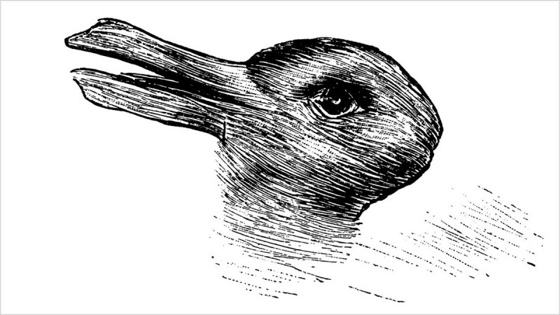 Super black-ink rabbit head in profile tattoo design