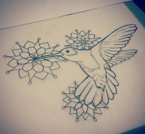 Super uncolored hummingbird flying on mandala flowers background tattoo design