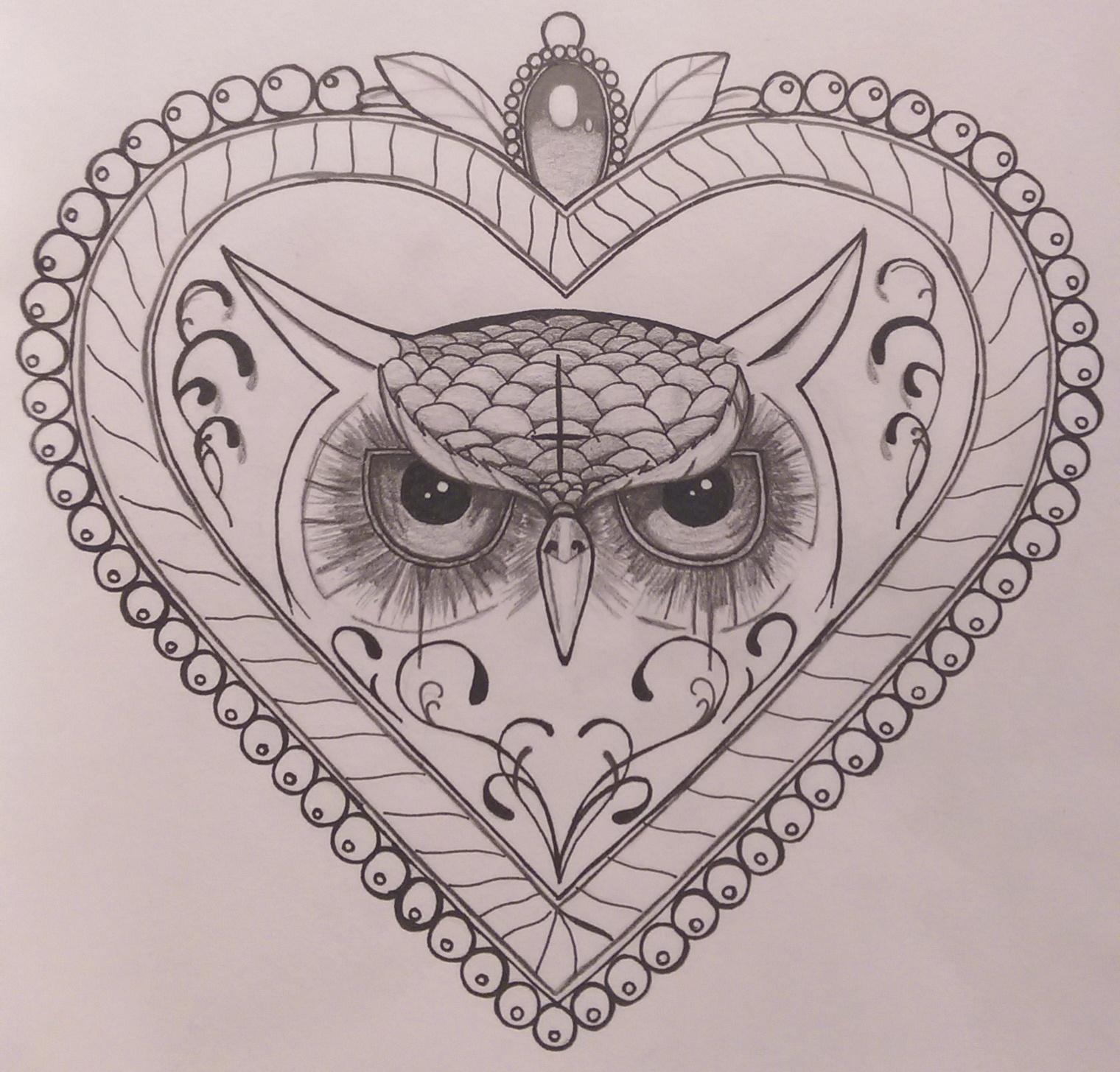 Sweet drawn owl head in heard frame tattoo design
