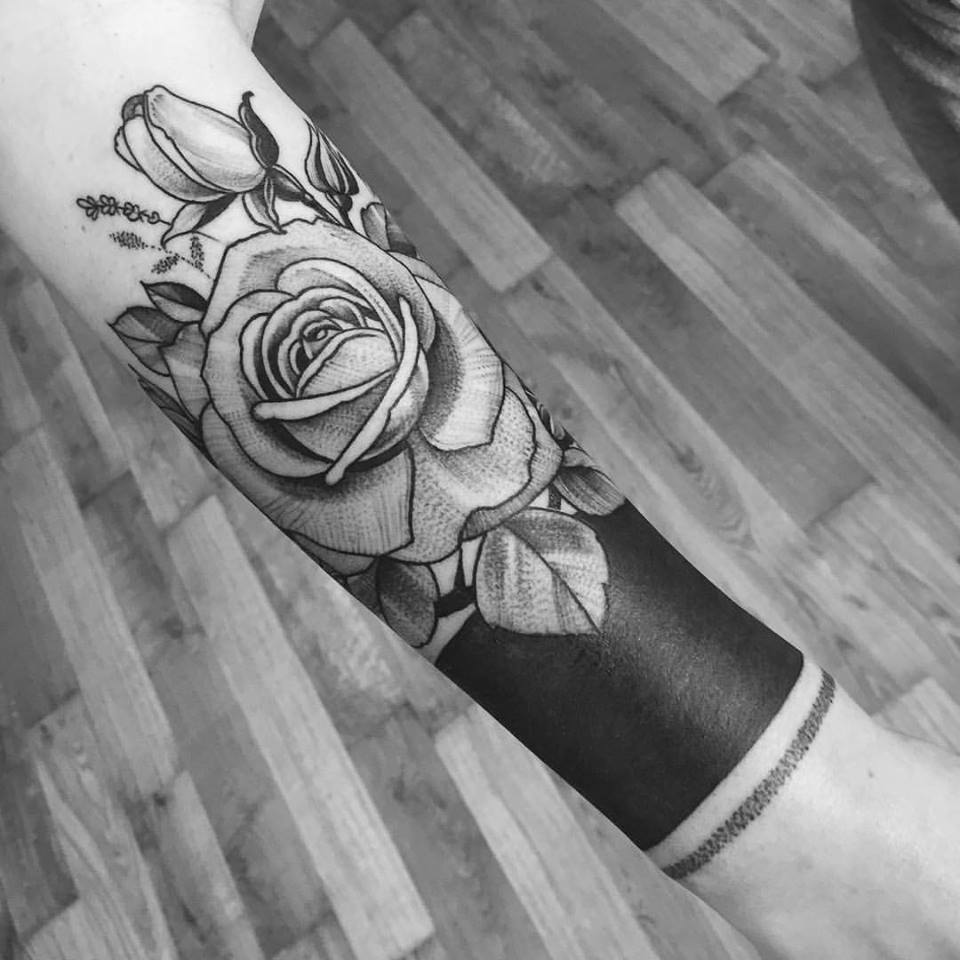Tattoo with roses on forearm