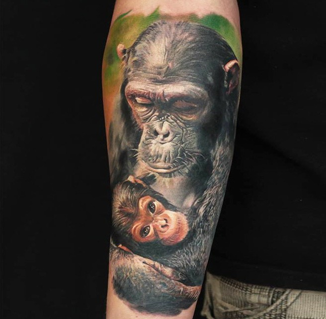 Tender color ink mother and baby chimpanzee tattoo on arm for Ink monkeys tattoo