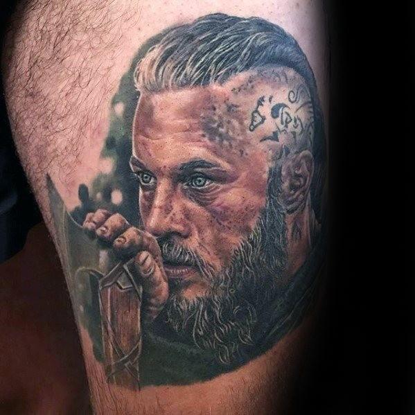Thigh tattoo with Ragnar portrait