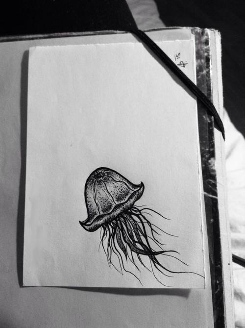 Tiny black jellyfish tattoo design
