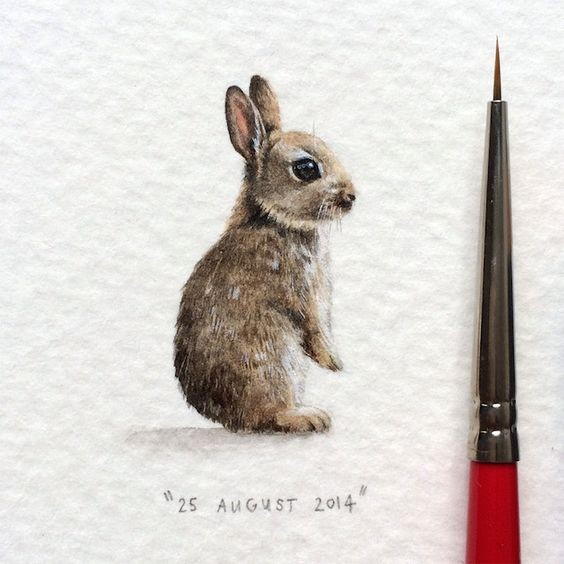 Tiny brown standing hare baby tattoo design