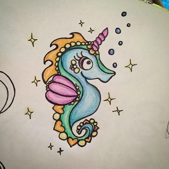 Tiny colorful unicorn-like seahorse tattoo design