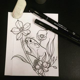 Tiny rodent crawling on flower stems tattoo design