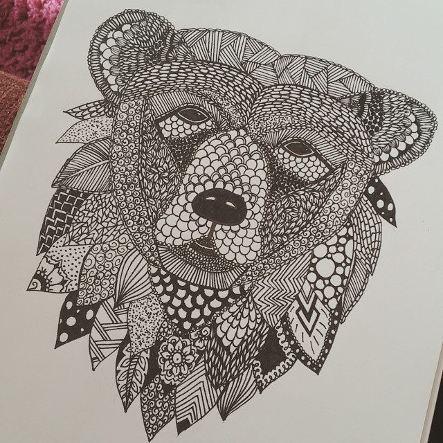 Tired grey-ink ornamented grizzly head tattoo design