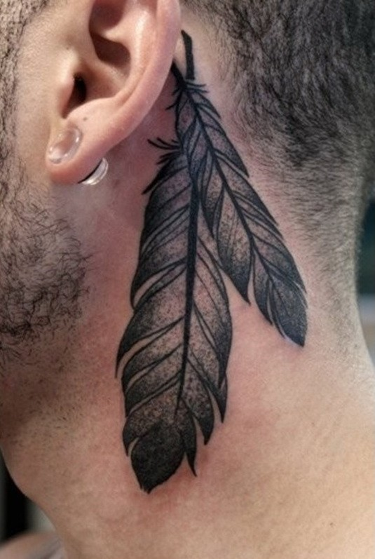 Traditional black-and-white eagle feather tattoo behind ear