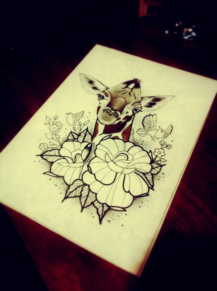 Traditional black-and-white giraffe with little birds and flowers tattoo design