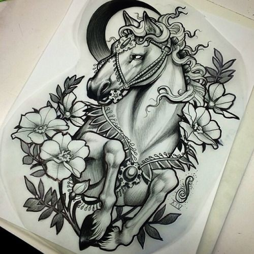 Traditional black-and-white horse surrounded with flowers tattoo design