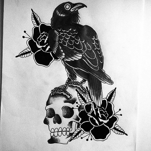 Traditional black-and-white raven sitting on skull with rose flowers tattoo design