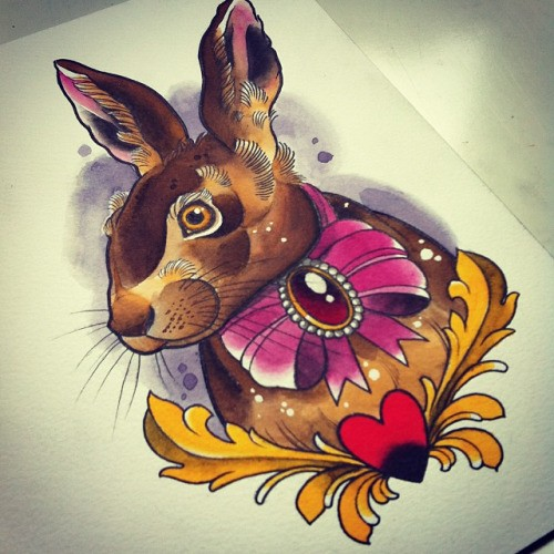 Traditional brown rabbit in pink bow tattoo design