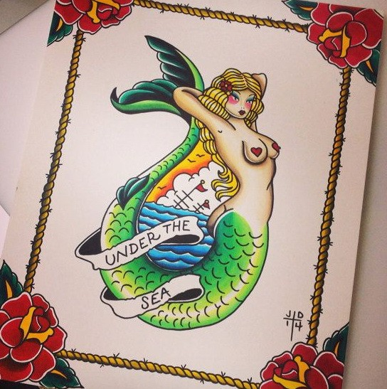 Traditional green-tail mermaid curled with banner tattoo design