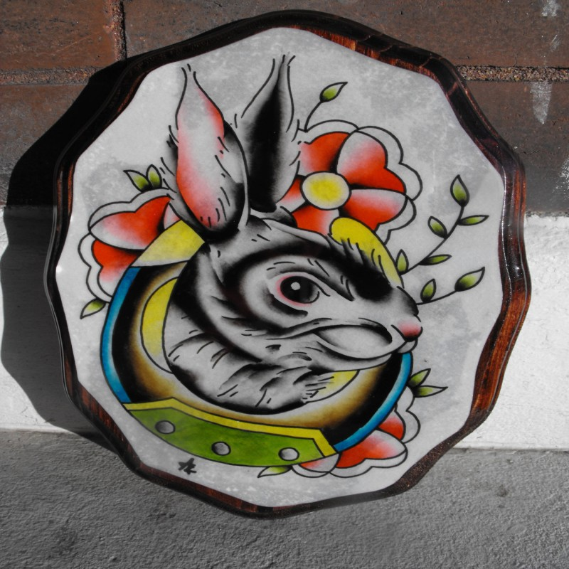 Traditional hare head with flowers and horse shoe tattoo design