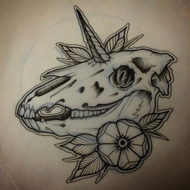 Traditional old school unicorn skull with a flower tattoo ...