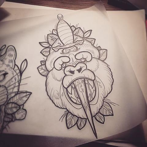 Traditional outline gorilla head pierced with dagger tattoo design