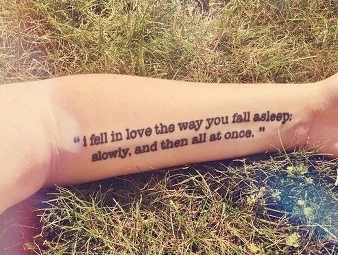 Traditional two-line quote tattoo on arm
