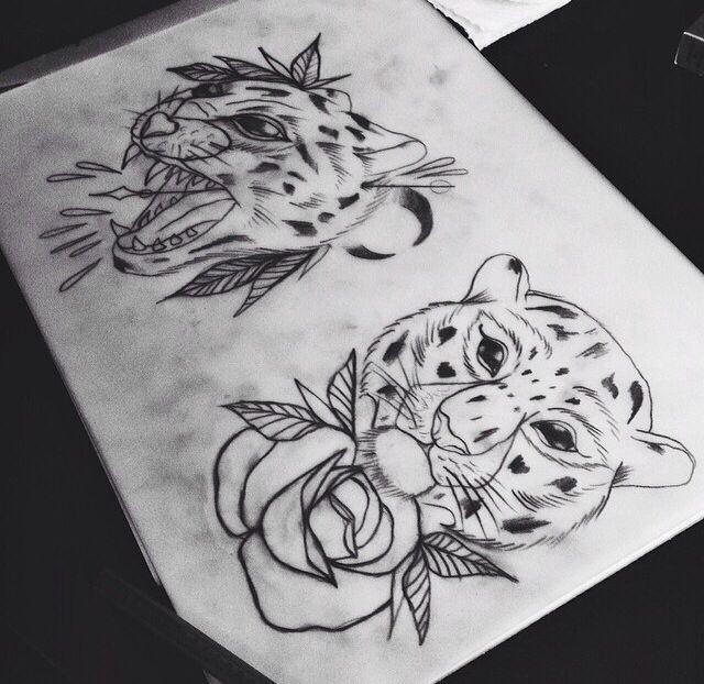Traditional uncolored cheetah heads with flowers tattoo design