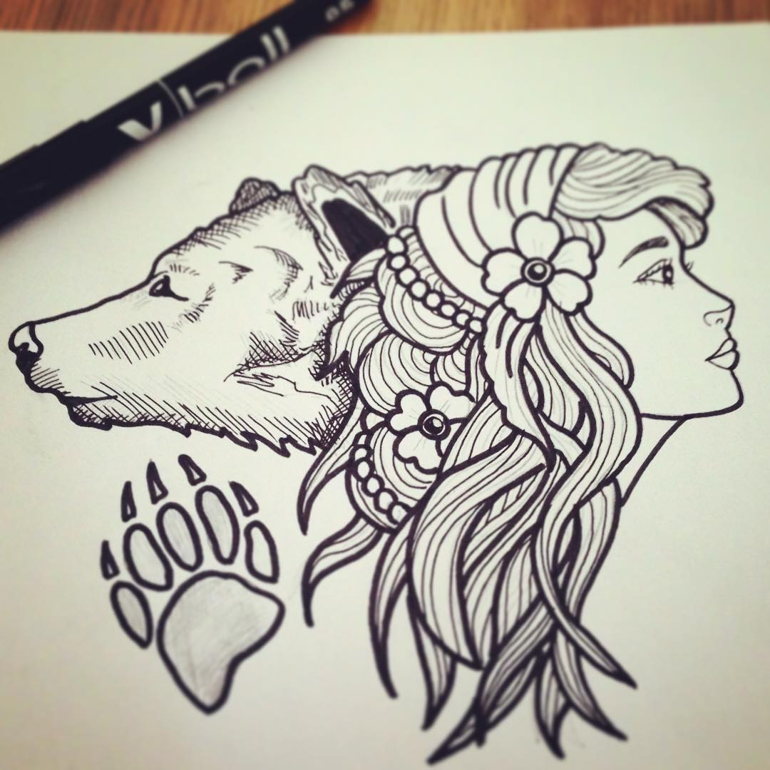 Traditional uncolored girl and bear heads with paw print tattoo design