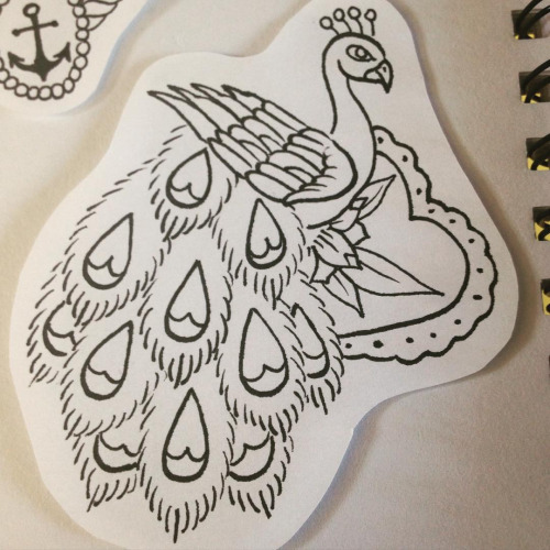 Traditional uncolored old school peacock and floweres heart tattoo design