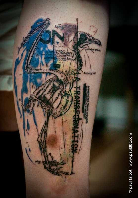 Trash polka style colored leg tattoo of bird skeleton with lettering