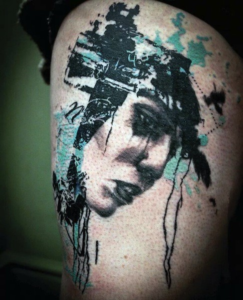 Trash polka style colored thigh tattoo of woman face with symbols