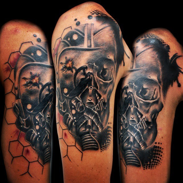 Trash polka style colored upper arm tattoo of pilot skull