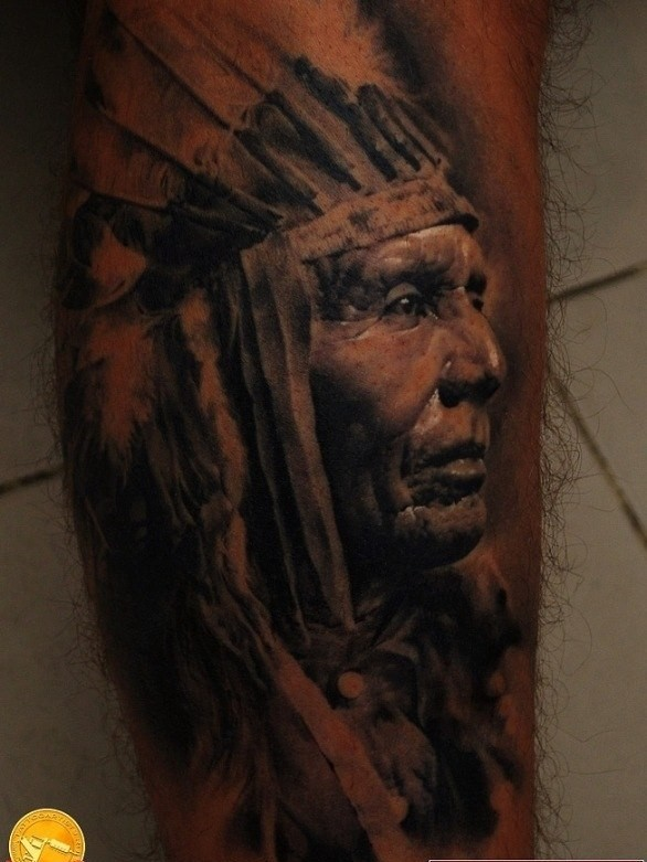 Tribe leader in profile tattoo on shin
