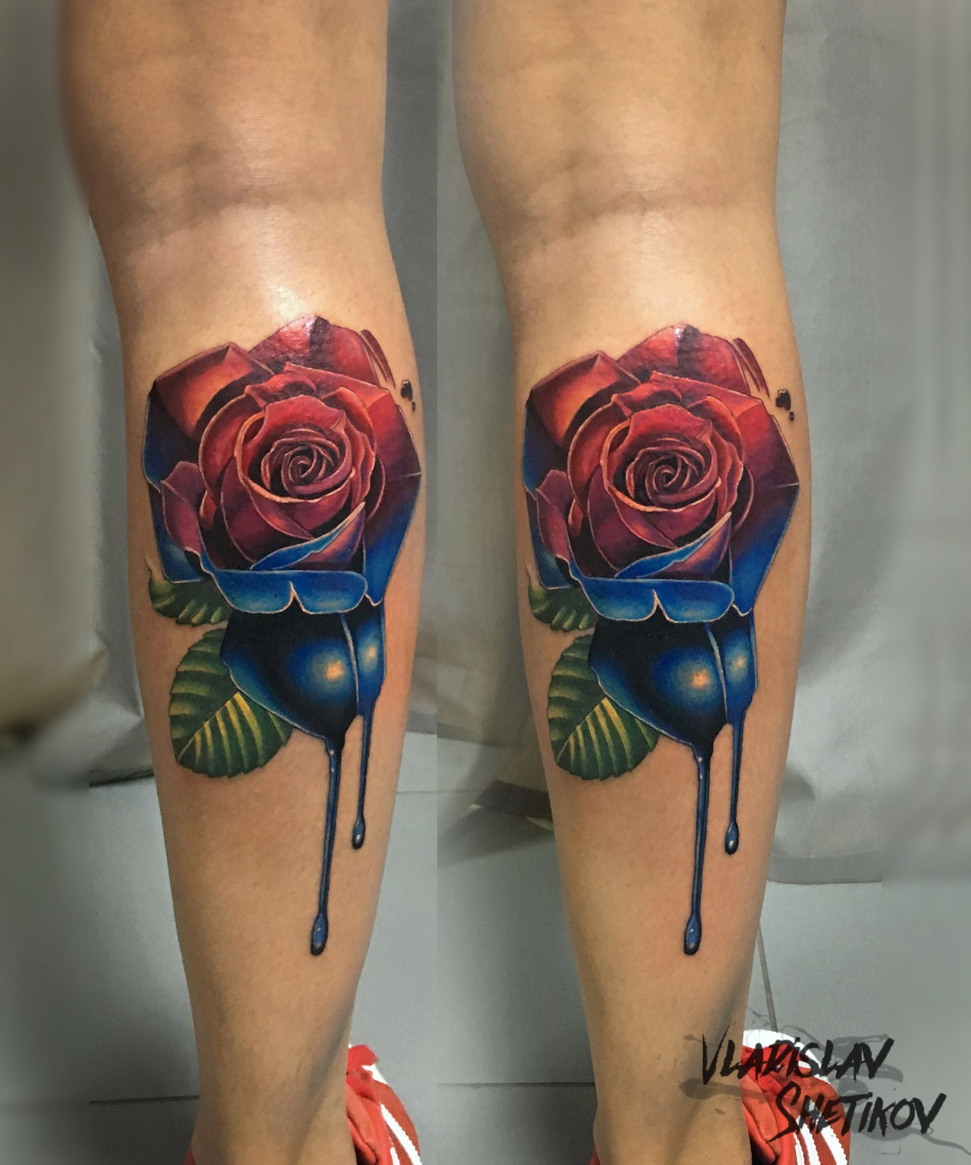 3cf4b04044e94 Two colors red and blue rose tattoo on leg by Vladislav Shetikov -  Tattooimages.biz