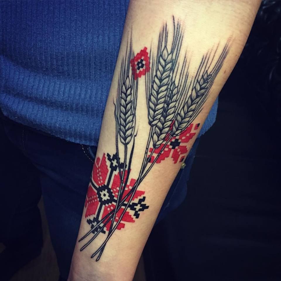 Ukrainian motives pattern and wheat spikelets tattoo