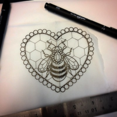 Uncolored bee decorated with jem and honeycomb heart in beaded frame tattoo design