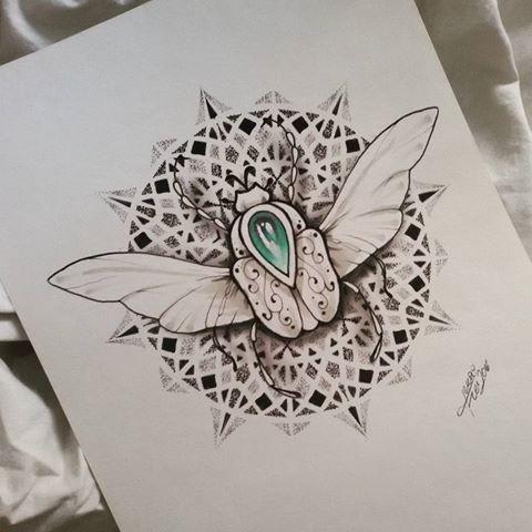 Uncolored bug with turquoise gem on round mandala background tattoo design
