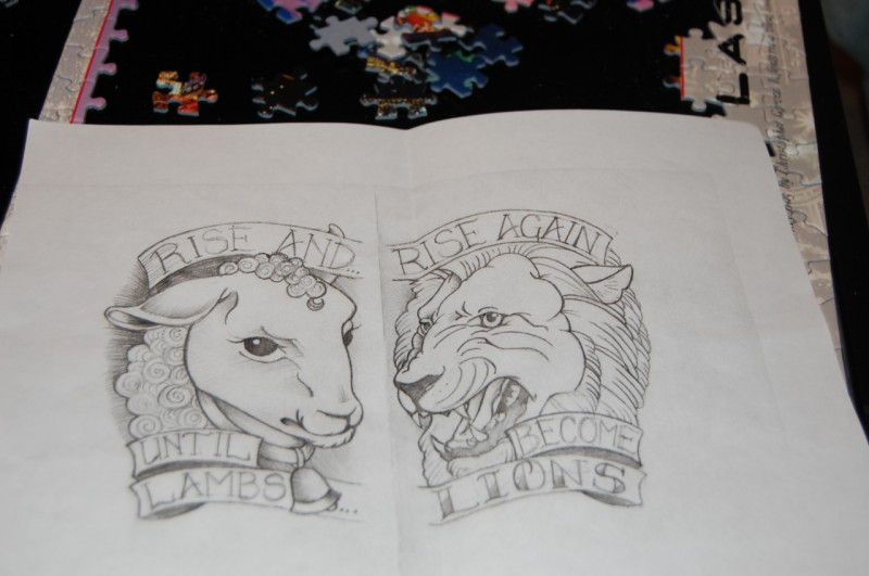 Uncolored sheep and lion portraits with striped letterings tattoo design