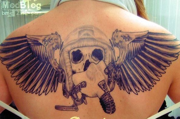 Unfininshed pilot dedicated upper back tatto of skull with mask and wings