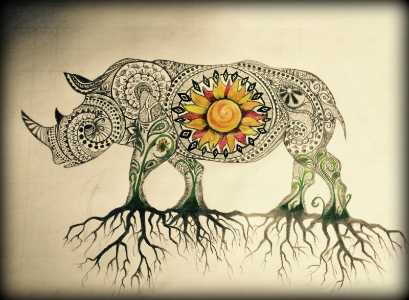 Unique ornamented bull with orange sunflower print and root legs tattoo design