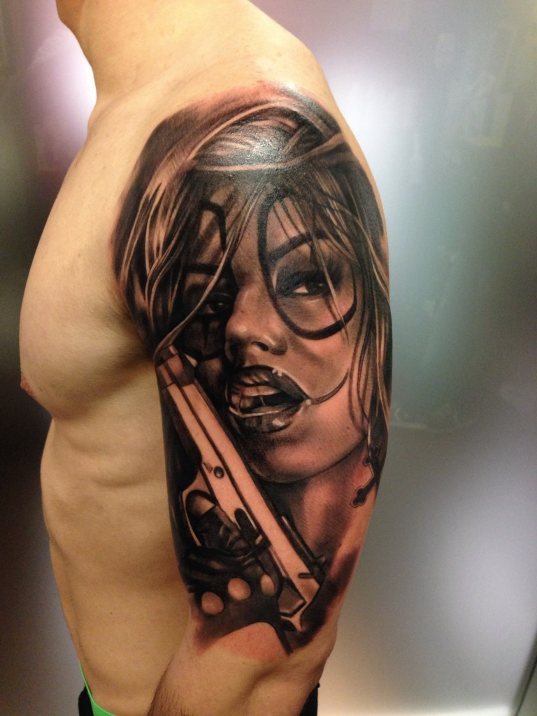 New school style colored shoulder tattoo of sexy clown woman with pistol