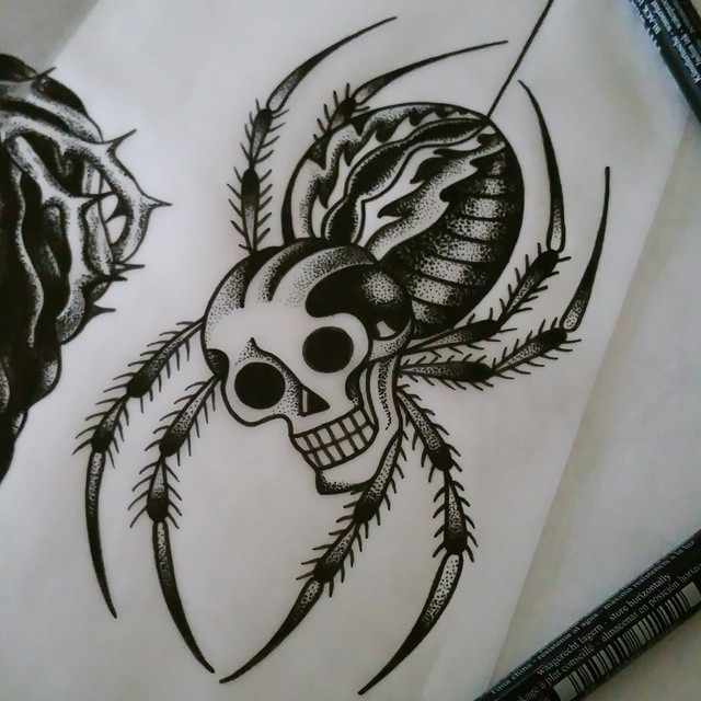 Unusual black-and-white spider with skull head tattoo design