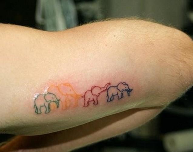 Unusual contour colored elephant family tattoo on arm