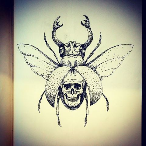 Unusual dotwork-style bug with skull print on testa tattoo design