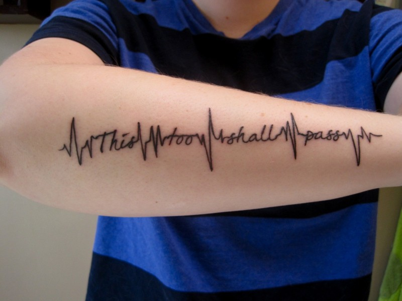 Unusual life heartbeat tattoo quote on arm