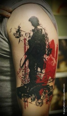 Unusual trash polka style colored upper arm tattoo of modern soldier with lettering